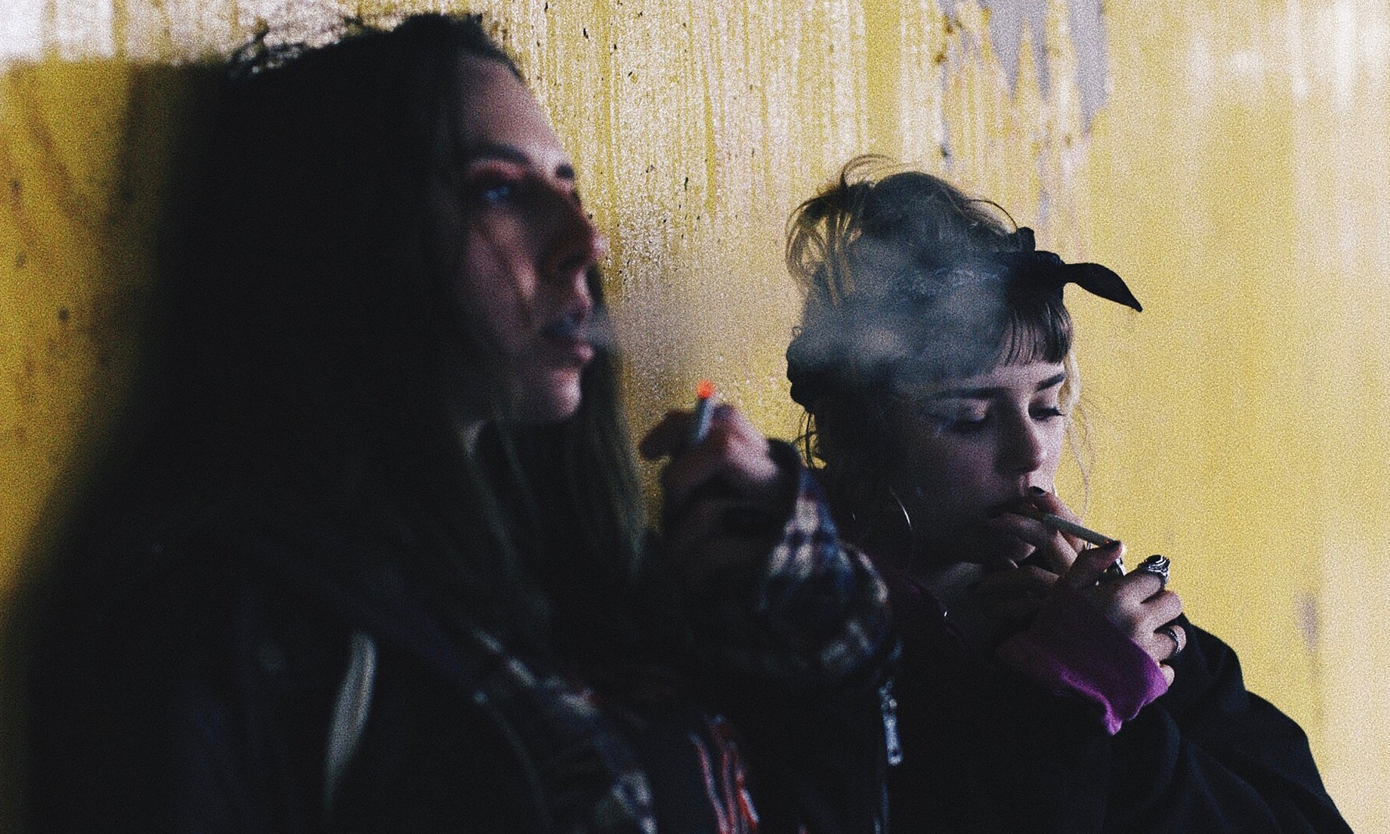 Two addicted burned out females smoking