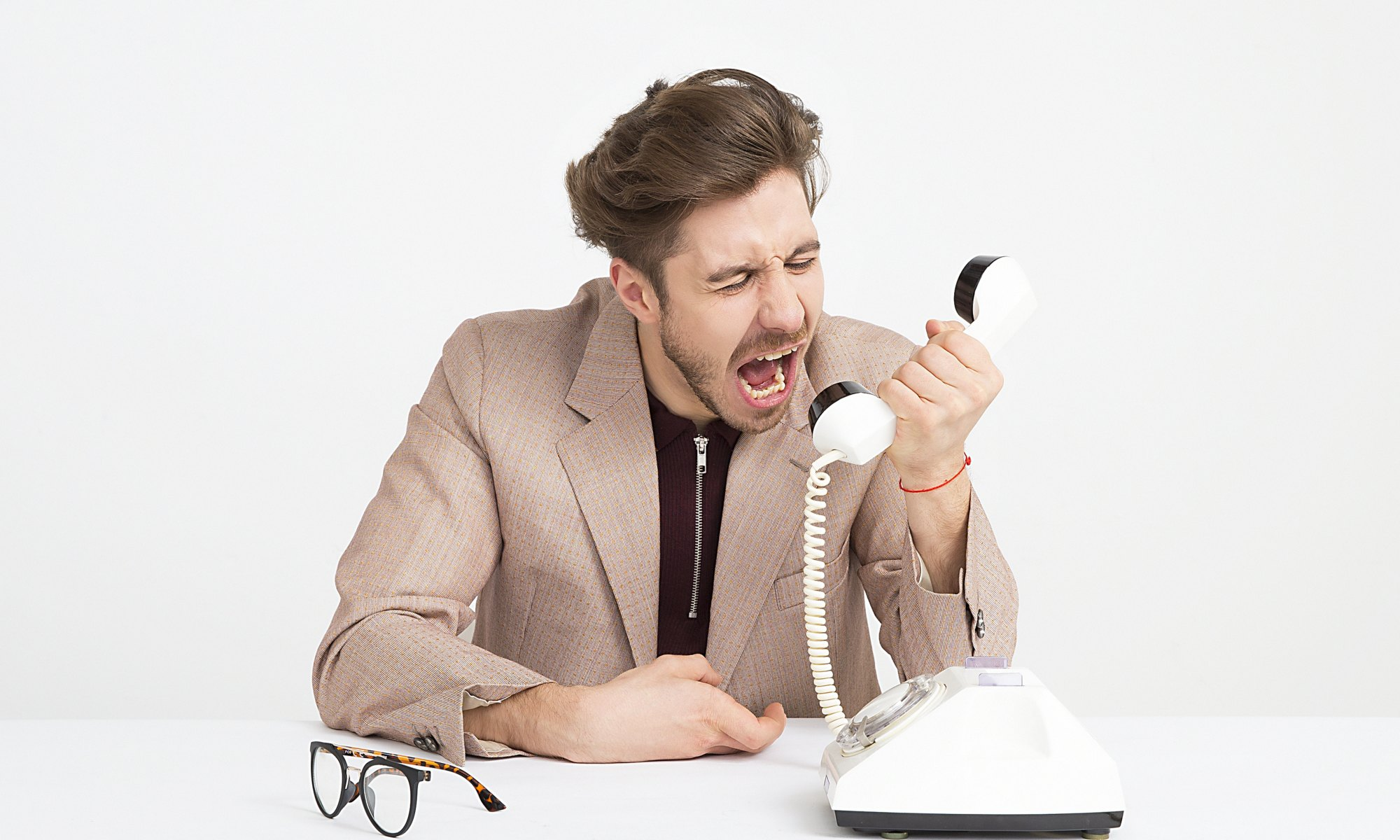 Cruel man holding telephone screaming
