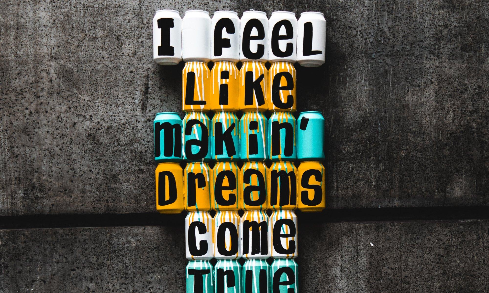 """Wall decor stating """"dreams come true"""""""