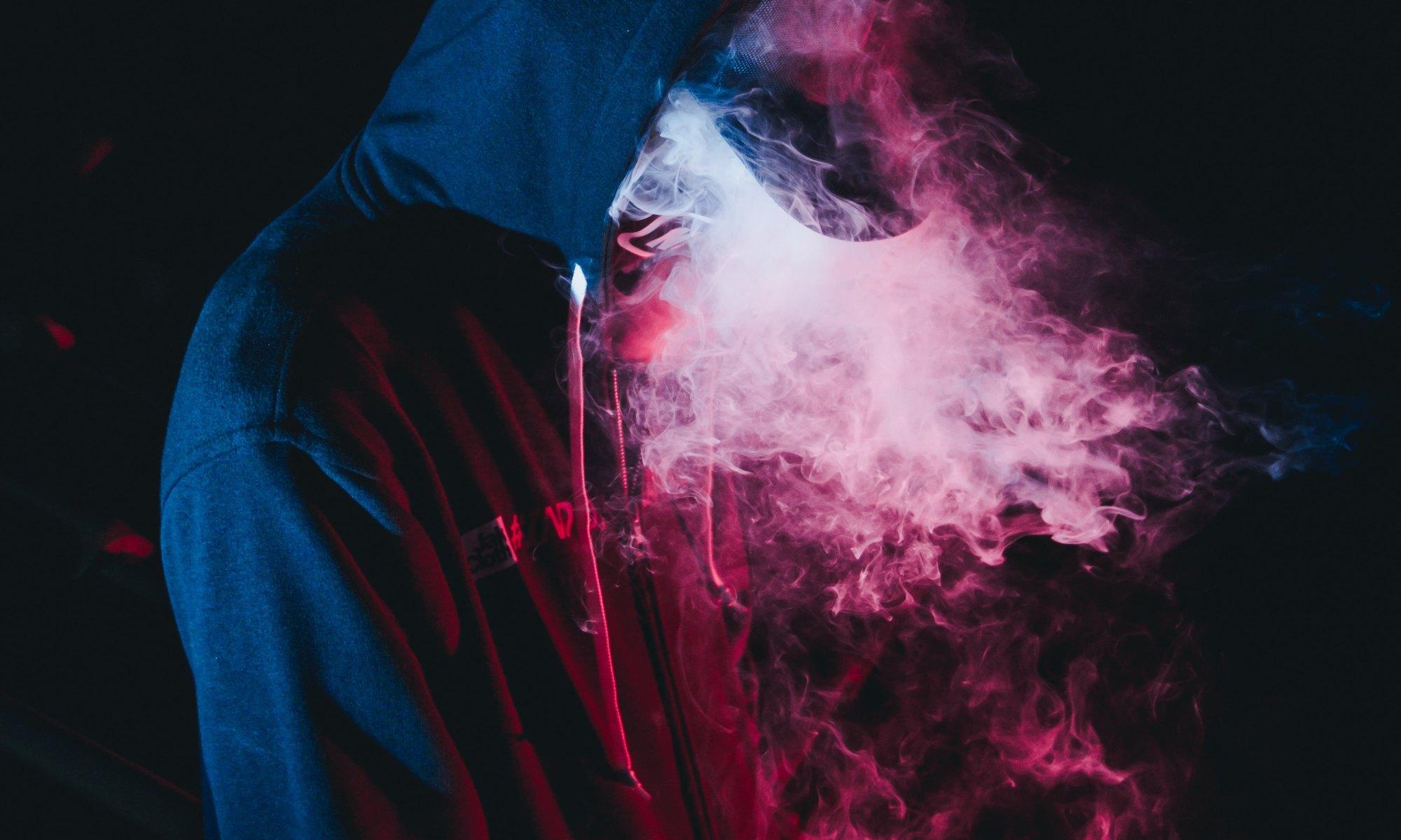 Person in black hoodie vaping