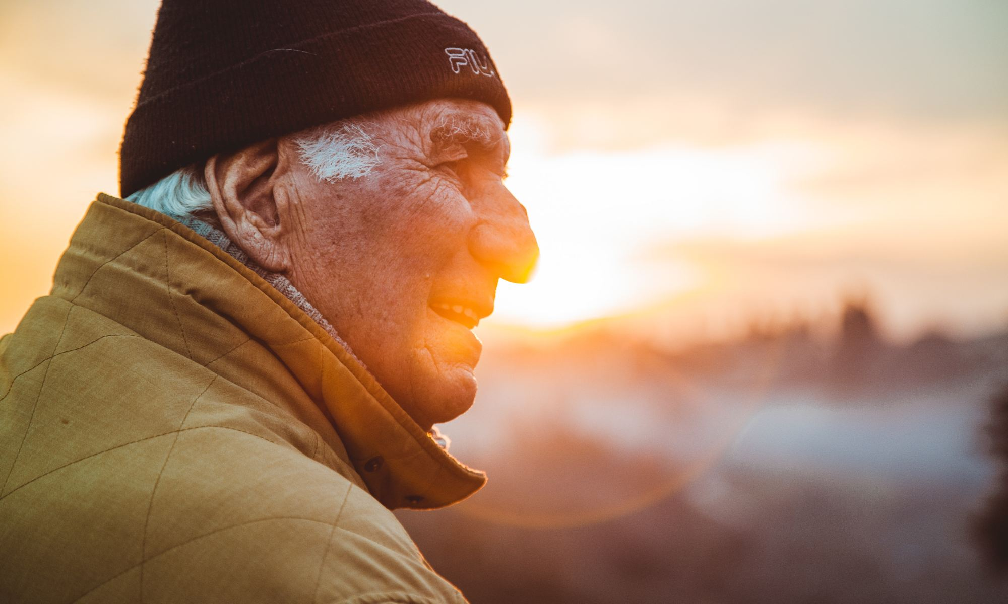 Elderly man with dementia staring in nature
