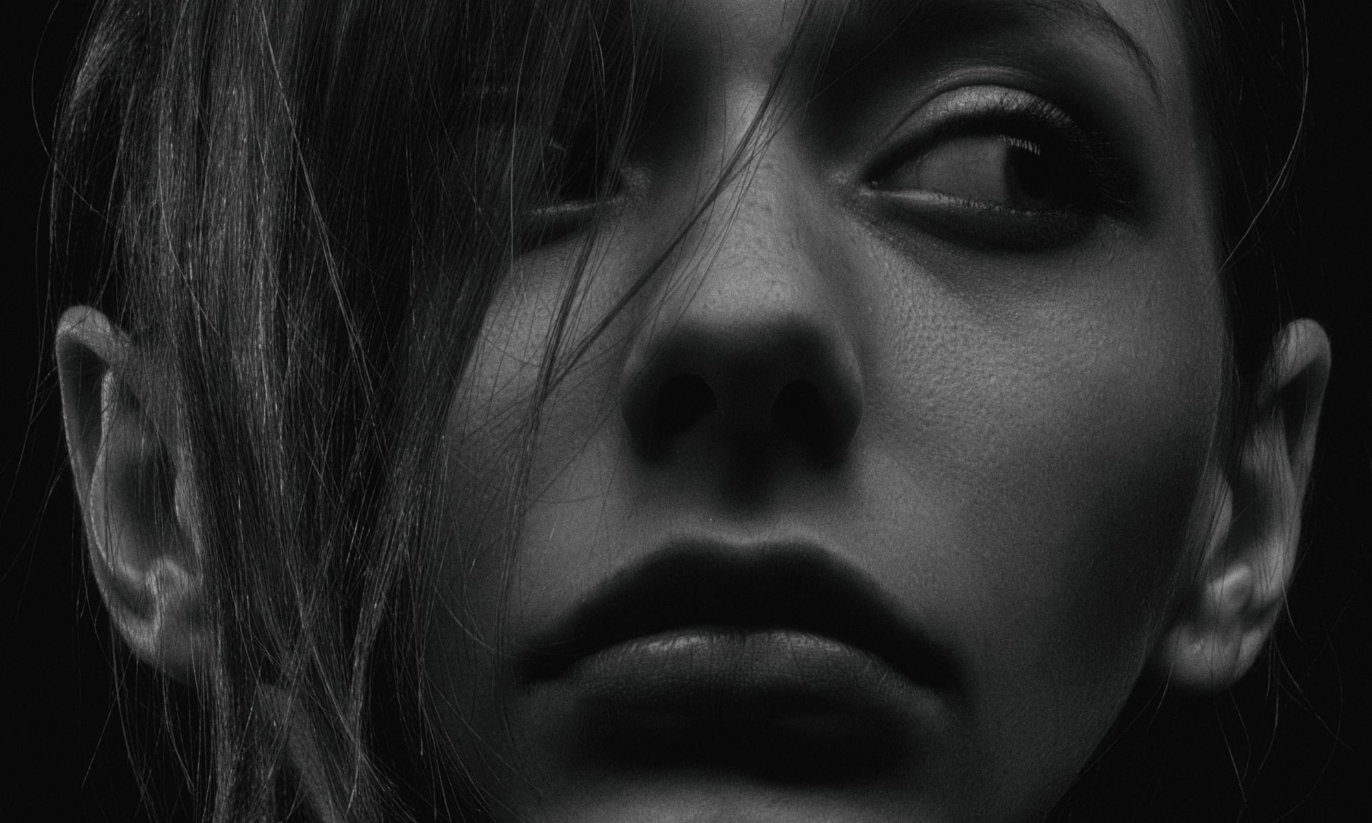 Grayscale photography of woman suffering from paranoid personality disorder