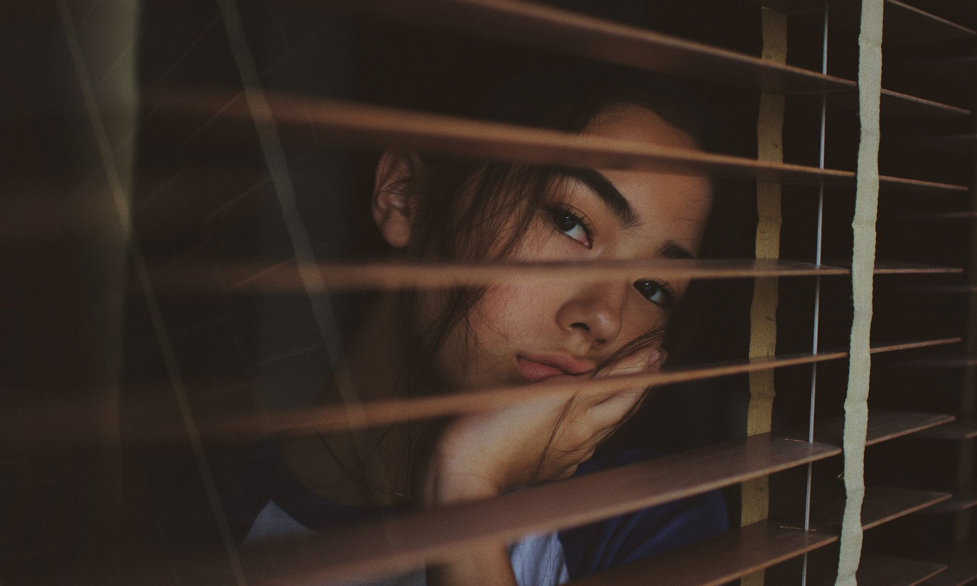 Young asian lady bored and staring out the window