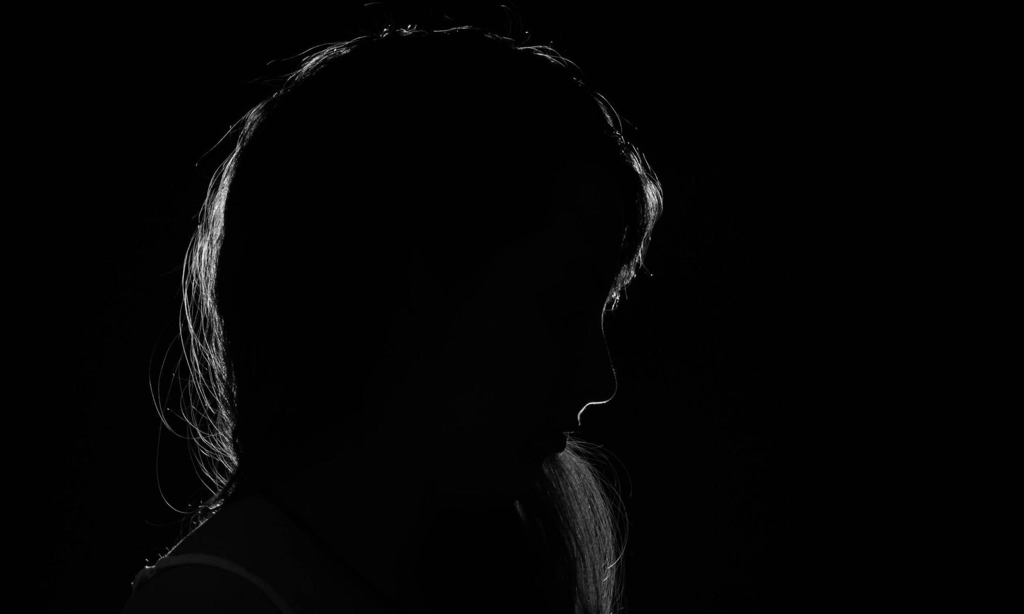 Silhouette photography of insecure woman