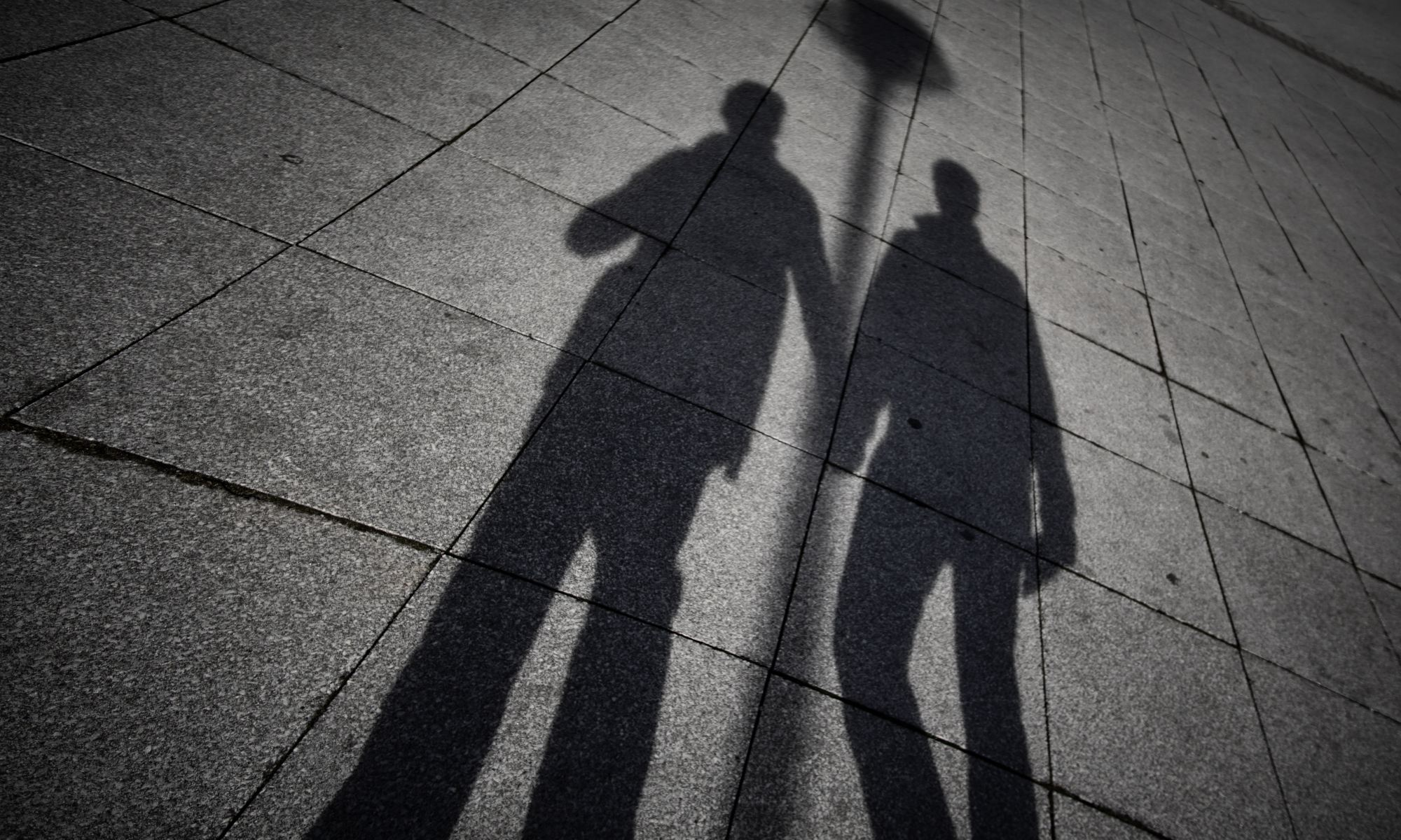 The shadow of two homosexual men holding hands