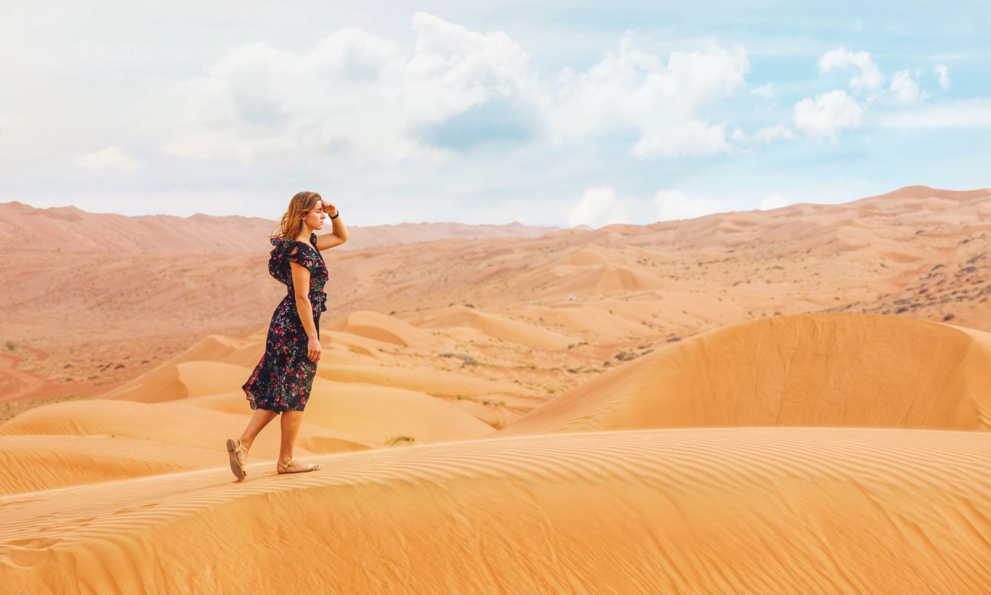 Young woman searching for answers while walking on sand dunes