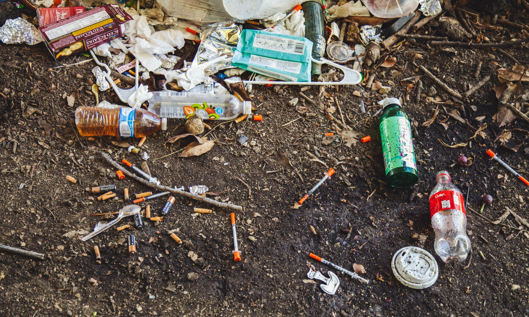 Heroin needles and trash on soil