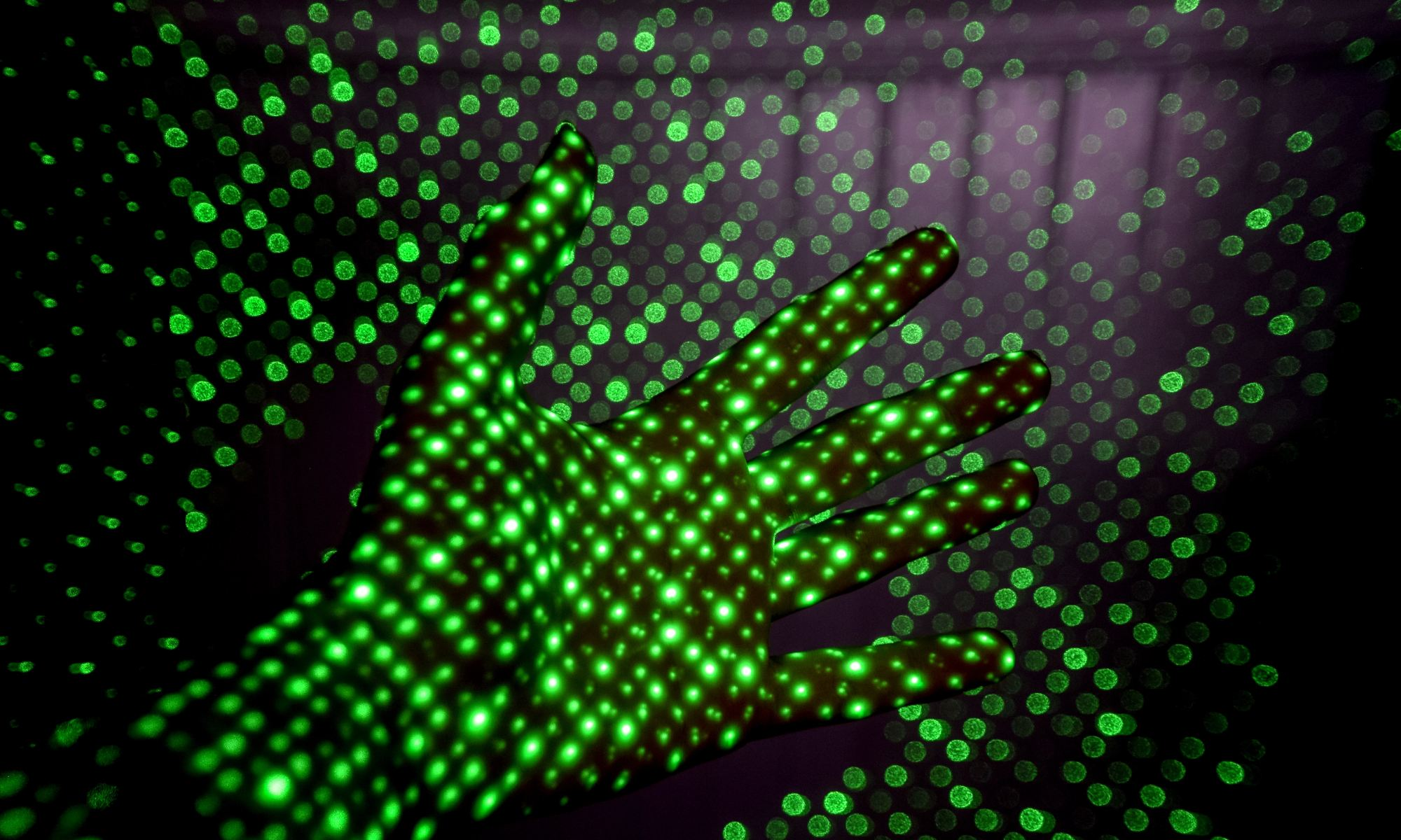 Psychiatrist's hand surrounded by green LED lights