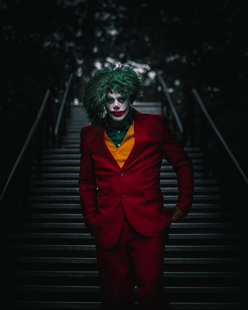 The Joker walking down steep city staircase