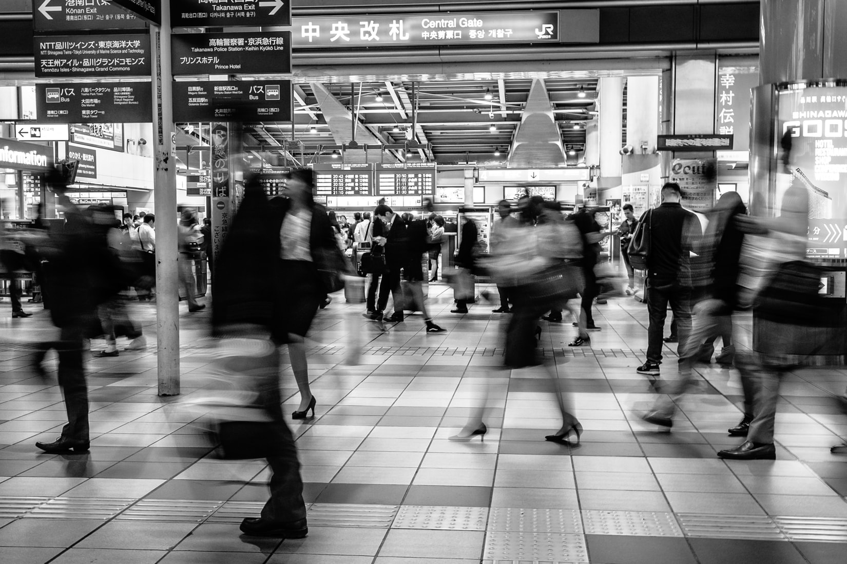 Time-lapse photography of people rushing through a subway station