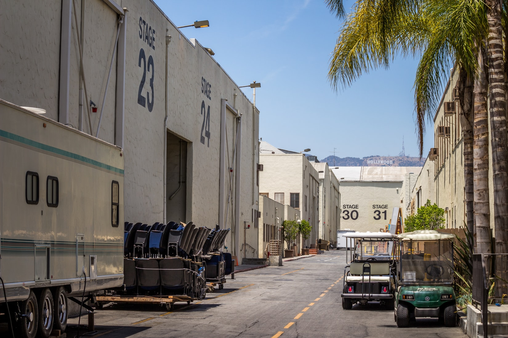 Hollywood movie studios, palm trees and carts parked on street