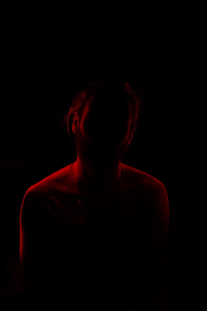 Silhouette of man sitting with a red outline around body