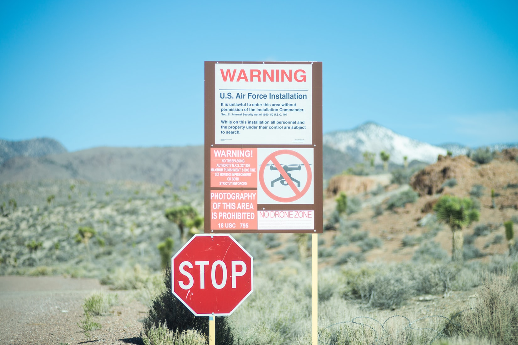 Stop sign and warning sign at the border of Area 51