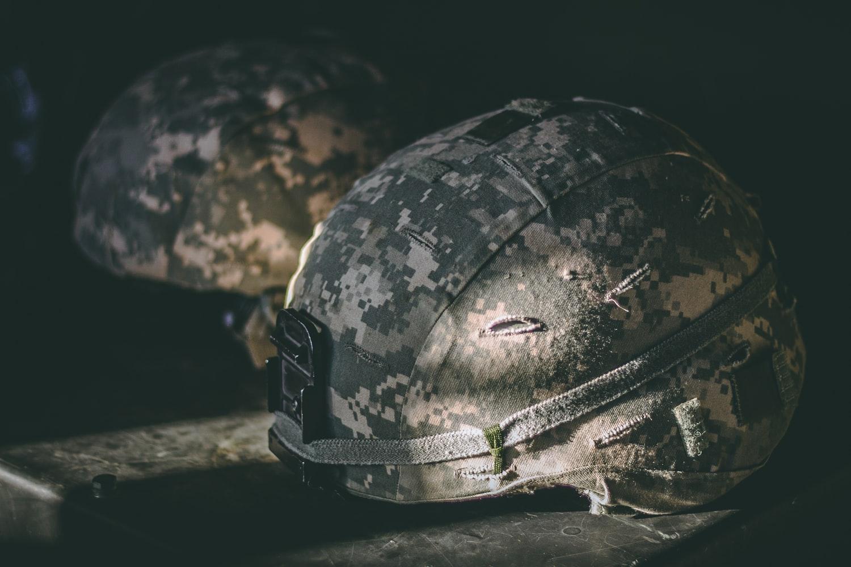 Brown military nutshell helmets on table