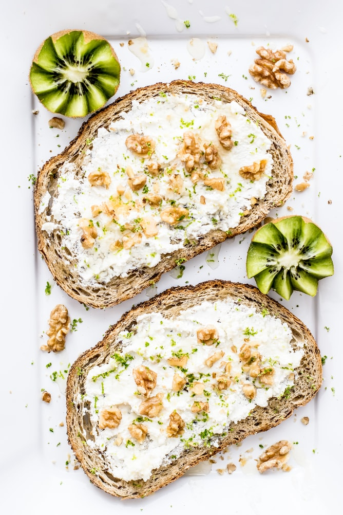 Plate of bread, nuts and kiwis