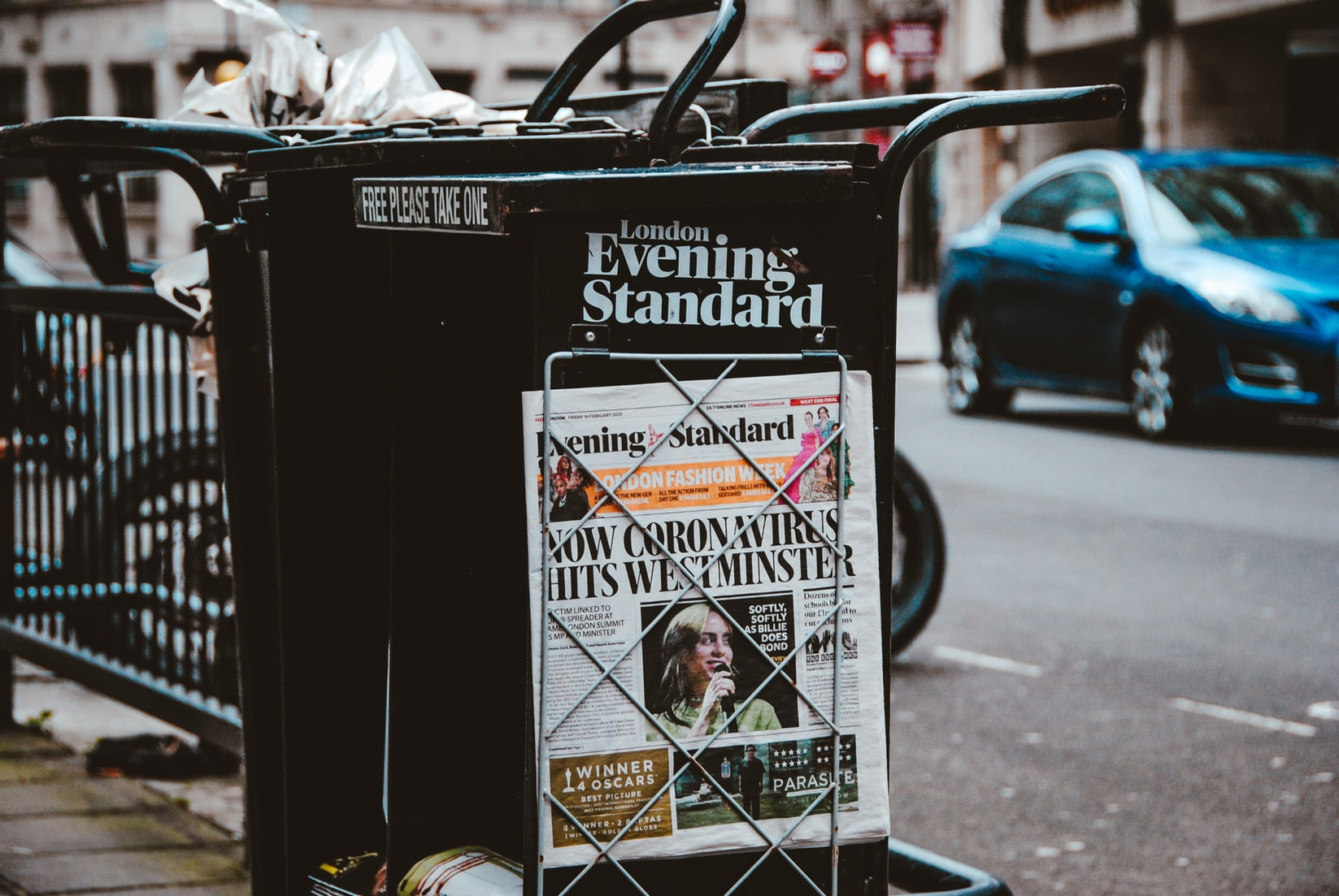 London evening standard newspaper with coronavirus headlines on sidewalk