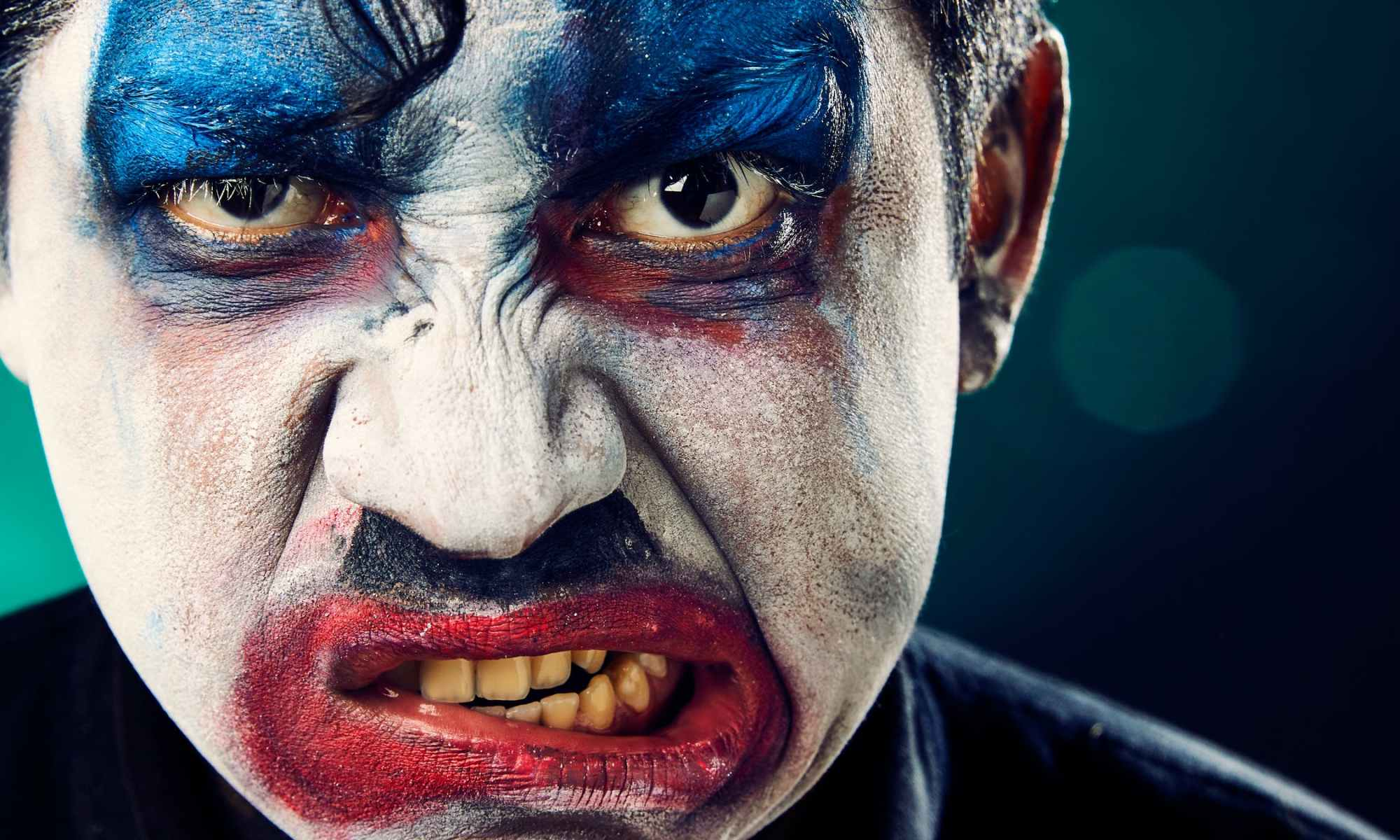 Angry man with colored clown face