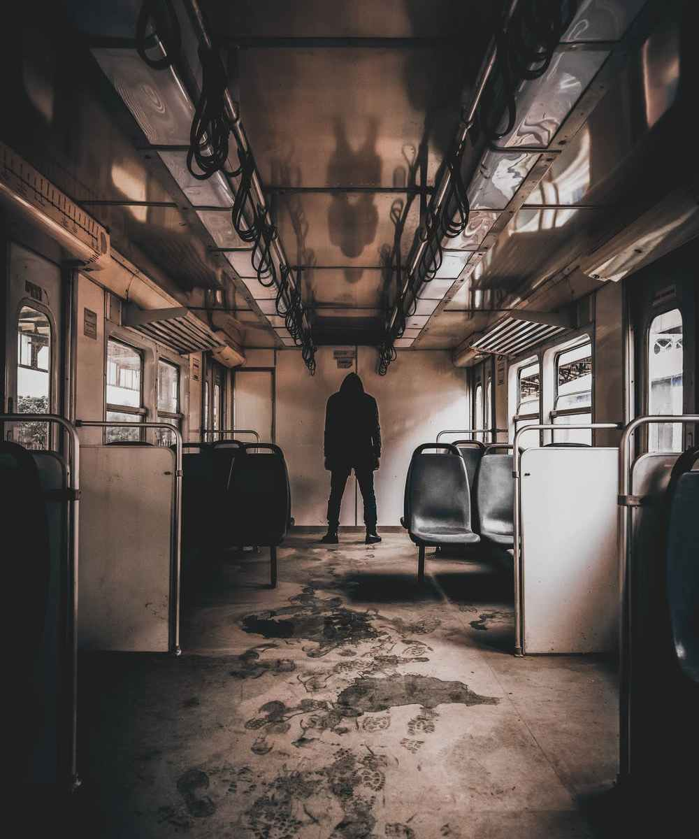 Psychotic man standing in empty train