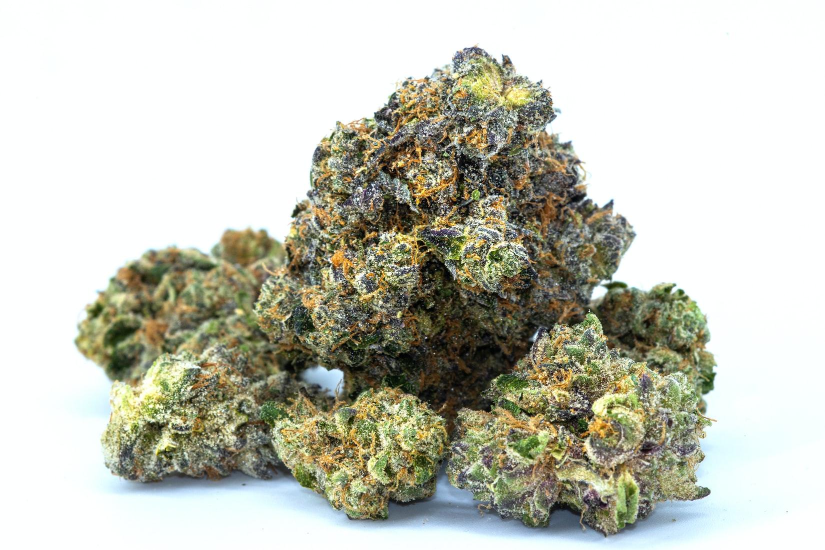 Green and orange marijuana buds