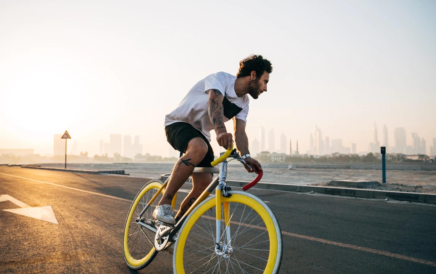 White man riding bicycle on road during daytime